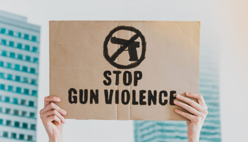 person's-hands-holding-a-sign-that-says-'stop-gun-violence'